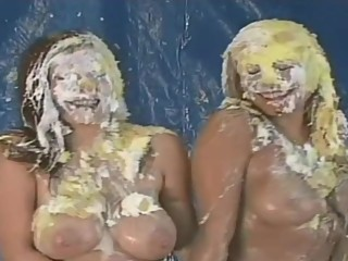 Two topless ladies pied