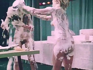 2-girl topless piefight bake-off!
