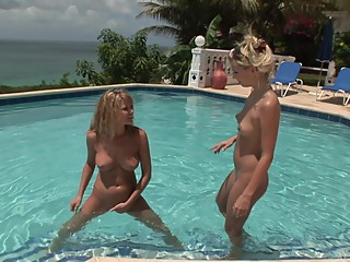 Carli and Jana nude around the pool