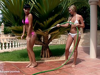 Carie and Natali play with water and have lesbian sex outdoors by Sapphic E