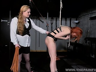 Suspended lesbian whipping and strict lezdom bondage of spanked slave girl