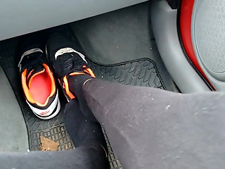 Girl with Nike airmax in car.