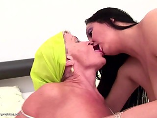 Old granny peeing on and fucks young lesbian girl