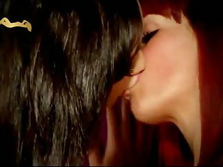 Redhead And Brunette Lesbians Kissing